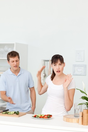 Young lovers having dispute in the kitchen photo