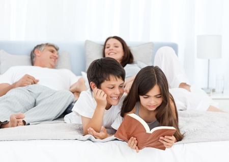 Parents talking while their children are reading photo