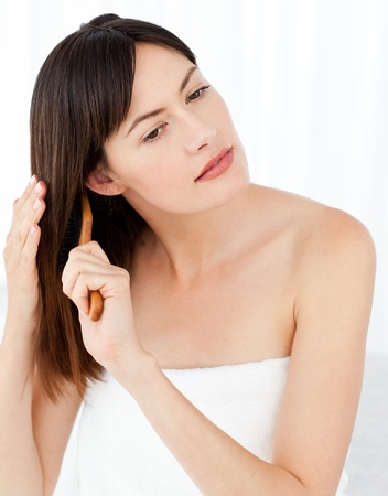 Beautiful woman brushing her hair Stock Photo - 10191892
