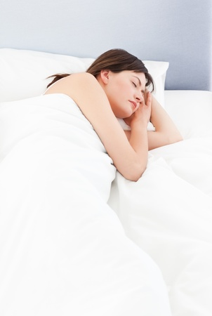 Woman sleeping in her bed photo