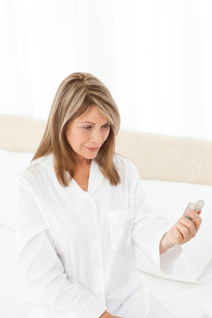 Sick woman taking her pills at home Stock Photo - 10194055