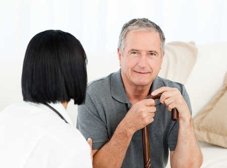 Retired man with his nurse  at home Stock Photo - 10197093