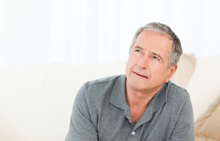 Mature man with his walking stick on his bed at home Stock Photo - 10197094