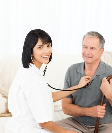 Nurse with her patient looking at the camera photo