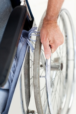 disability insurance: Senior in his wheelchair phoning at home