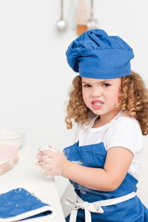 A little girl  baking with her grandmother at home Stock Photo - 10197159
