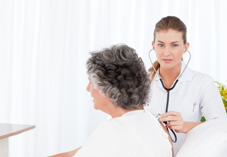 Nurse taking care of her patient Stock Photo - 10195227