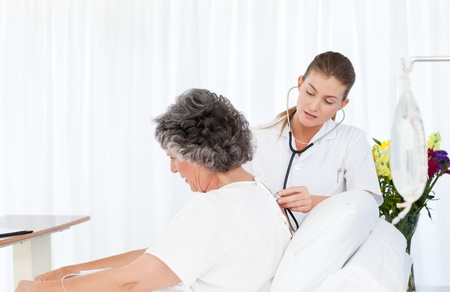 Nurse taking care of her patient photo
