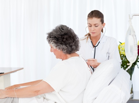 Mature woman talking with her nurse Stock Photo - 10195418