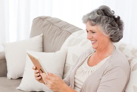 Woman looking at a photo at home photo