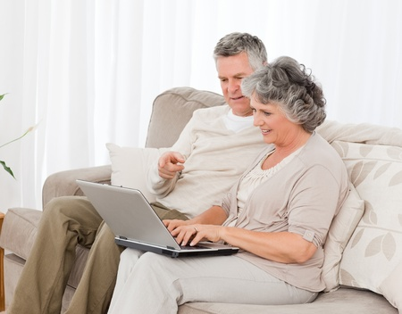 Seniors buying something on internet at home photo