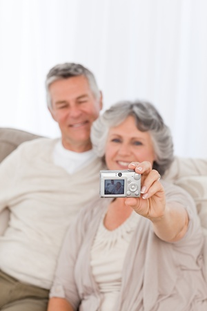 Couple looking at a photo at home Stock Photo - 10196833