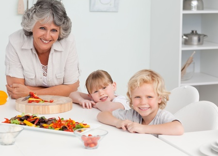 Family cooking together in the kitchen at home photo
