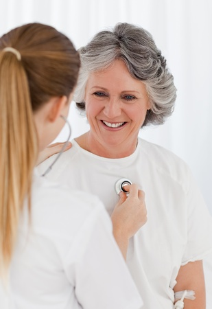 Nurse taking the heartbeat of her patient Stock Photo - 10196939