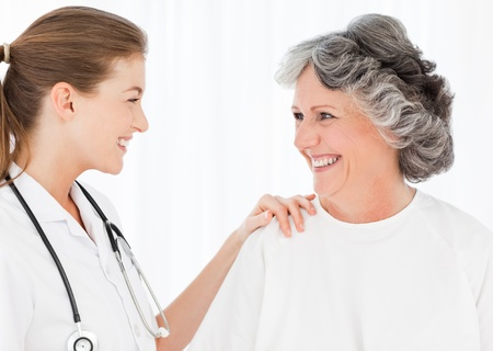 Patient with her nurse smiling photo