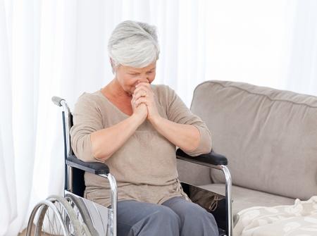 Thoughtful senior in her wheelchair photo