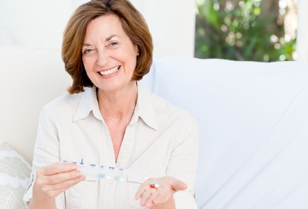 Cute mature woman with pills photo