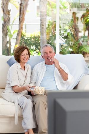 Seniors watching tv at home photo