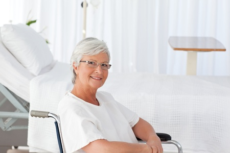 Happy woman  looking at the camera in a hospital photo