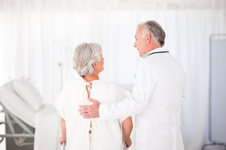 Doctor speaking with his patient photo