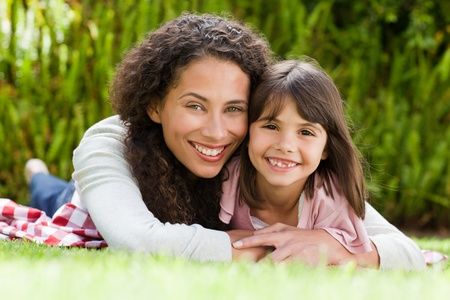 Adorable mother with her daughter in the garden Stock Photo - 10197316