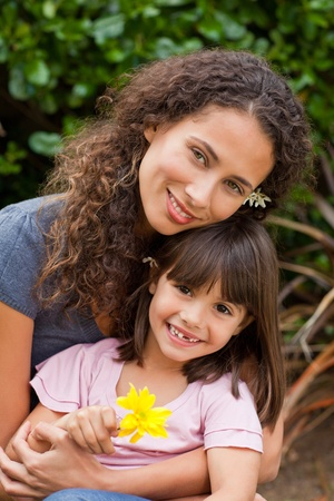 single moms: Portrait of a joyful mother with her daughter in the garden Stock Photo