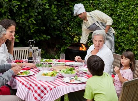 Man having a barbecue in the garden  photo