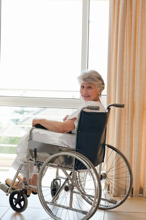 amputation: Woman in her wheelchair looking at the camera