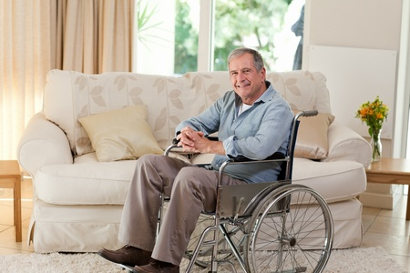 Senior man in his wheelchair photo