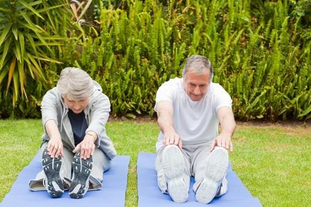 Senior couple doing their streches photo