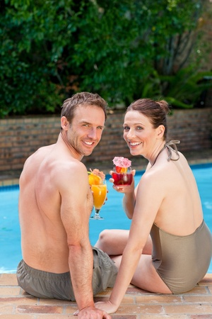 Happy couple drinking cocktails Stock Photo - 10190487