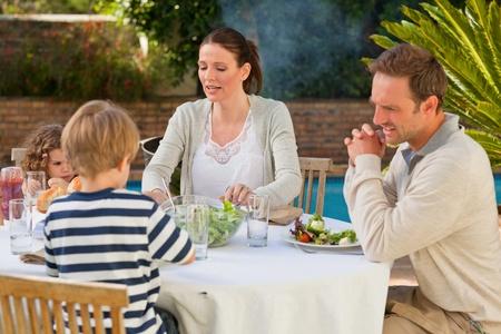 Family eating in the garden photo