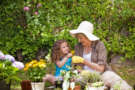Happy Grandmother with her granddaughter working in the garden Stock Photo - 10190358