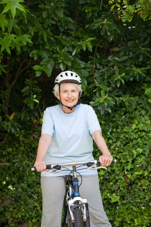 Mature woman mountain biking outside Stock Photo - 10190112