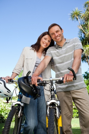 Joyful couple with their bikes photo