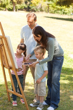 Family painting together in the park Stock Photo - 10197373