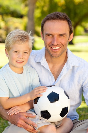 Father with his son after a football game photo