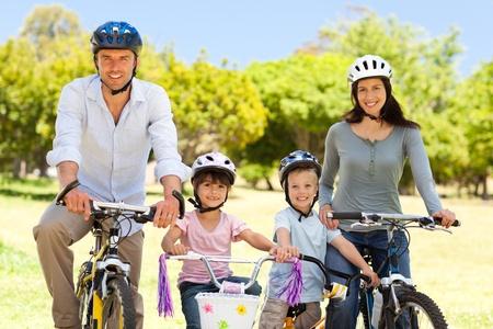 Family with their bikes photo