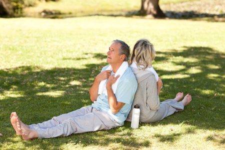Couple after their streches in the park photo