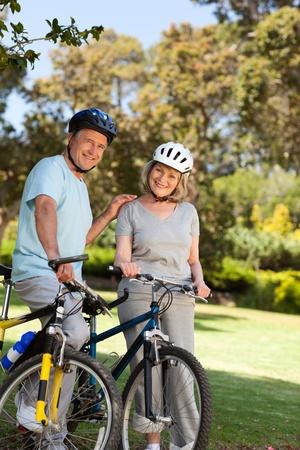 Elderly couple with their bikes Stock Photo - 10190216