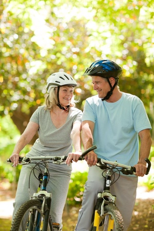 Couple with their bikes in the wood photo
