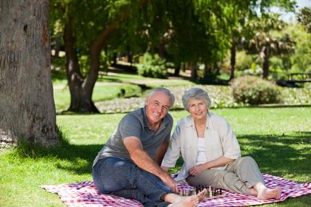 picnicking: Senior couple  picnicking in the garden