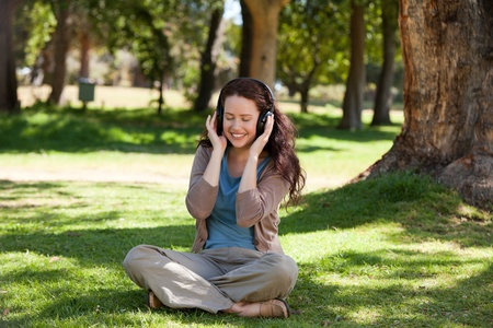 Woman listening to some music in the garden photo