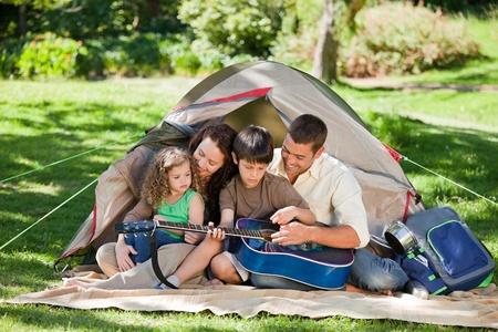Joyful family camping photo