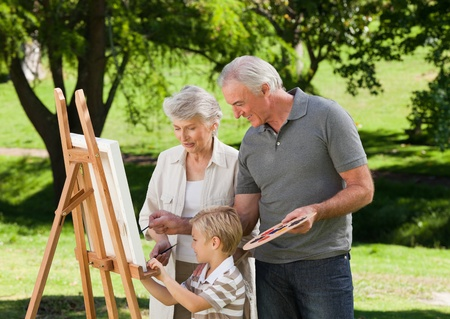 Family painting in the garden photo