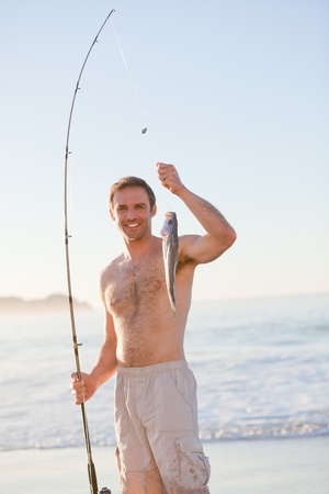 Active man fishing photo