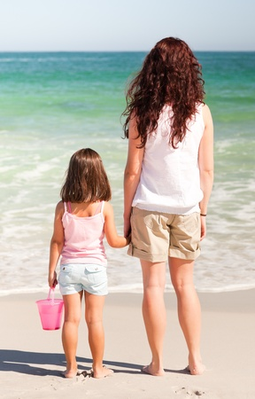 Mother and her daughter on the beach photo