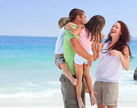 Happy children playing with their parents photo