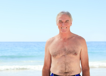Mature man at the beach Stock Photo - 10196660