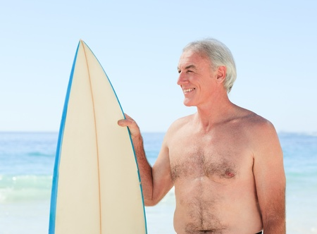 Retired  man with his surfboard Stock Photo - 10191583